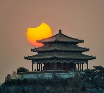 Partial Eclipse over Beijings Forbidden City