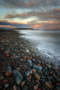 Pastel Pebbles dot the beach at Lawrencetown Beach Nova Scotia Canada