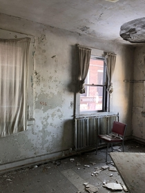 Patient room in abandoned mental health hospital
