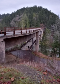Pedestrianbicycle bridge suspended from under the motor vehicle bridge Olympic Discovery Trail over the Elwah River Washington State USA