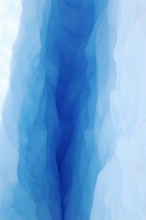Peering down a crevice in the Perito Moreno Glacier Argentina