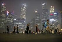People take photos with the skyline of the central business district shrouded by haze in Singapore on September   Edgar Su