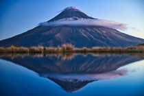 Perfect reflection at Mt Taranaki New Zealand  By marcograssiphotography