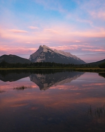 Perfect reflection of Mount Rundle during sunset Vermilion Lakes Alberta Canada