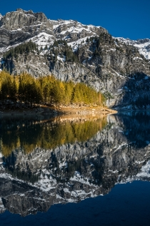 Perfect symmetry at lake Oeschinen Kandersteg Switzerland