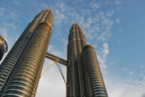 Petronas Twin Towers in Kuala lumpur Lumpur Malaysia are the tallest twin towers in the world The towers were designed by Argentine architect Csar Pelli