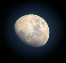Photo I took of the moon during the afternoon by holding my phone up to a cheap telescope