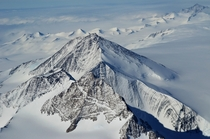 Photo of a mountain in Antarctica from the window of a Boeing