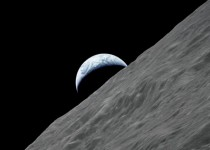 Photograph taken from the Apollo  spacecraft in  as the Earth rises above the lunar horizon