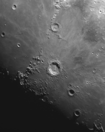 Photographing the Moon through a telescope allows for shadows across mountains and craters to become prominent