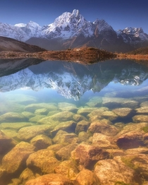 Phungi peak m reflecting on Bimtang lake  m Nepal by Anton Jankovoy