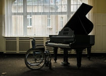 Piano and Wheelchair in Abandoned Luxury Hotel