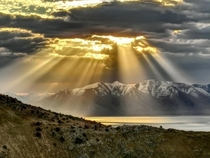 Picture a friend of mine took at the Great Salt Lake Stansbury Island The light through the clouds is absolutely stunning