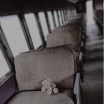 Picture of a teddy bear on an abandoned train