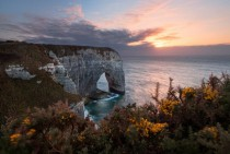 Picturesque sunset over limestone arch in Manneport Etretat