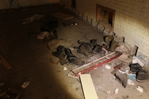 Pile of boots mysteriously left in the distribution center of an abandoned prison