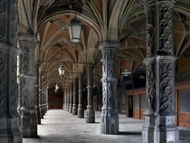 Pillars line the cloisters along the edge of the central courtyard at a historic trading house in Belgium