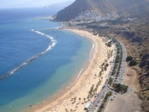 Playa Teresitas in Tenerife - yellow sand hauled from Sahara and artificial barrier built to prevent sea from stealing the sand