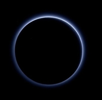 Pluto captured by the New Horizons probe backlit by the Sun