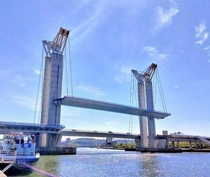 Pont Gustave-Flaubert in France one of the largest vertical lift bridges in the world The center span can be raised up to  feet high and each side can be raised or lowered separately