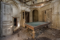 Pool table in an abandoned chateau Photo by MGness_