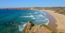 Portugal has some of the best beaches Ive seen outside Australia Outstanding colours Praia do Amado