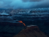 Predawn sunlight strikes the South Rim of Arizonas Grand Canyon photo by David Stoker