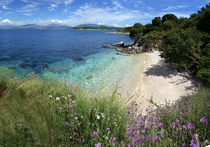 Private dream beach in the low season on Corfu Greece