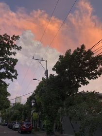 Probably one of the coolest sunsets Ive seen from the middle of Manila Philippines
