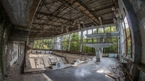 Public pool in Pripyat Ukraine Slowly reclaimed by nature