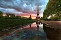 Puddle reflection of Eiffel Tower Paris France