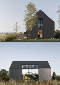Pure black sculpture house built on a plot in the Zuidplaspolder Netherlands by Studio AAAN Photo Sebastian Van Damme