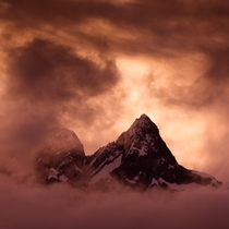 Pyramid Peak enveloped by clouds at sunset Southern Alps NZ  OC