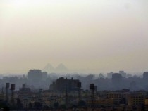 Pyramids through the smog Cairo Egypt