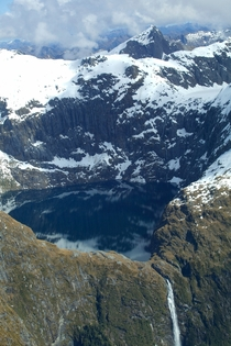 Queenstown NZ Flying over a mountain with lake and waterfall