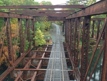 Railroad bridge on a rainy October afternoon in New England  Pin-Connected Pratt Truss Millville MA