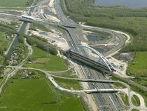 Railway bridge over a major highway under construction in the Netherlands