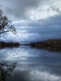 Rain clouds over the Mississippi River in Ontario Canada  OC