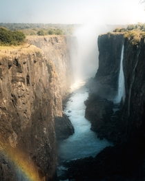 Rainbow emerging from the mist at Victoria Falls in Zambia  IG mvttmic