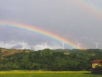 Rainbow over a windmill farm clicked in Rizal Philippines