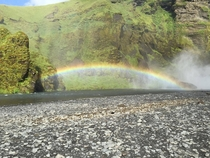 rainbow over stream iceland