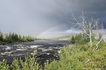Rainbow peaking out of thunderstorm Labrador Canada