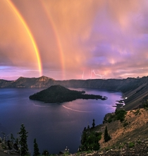 Rainbows and lightning on Crater Lake Oregon Photo by Jasman Mander