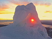 Rainer Sunrise through ice  ft on Emmons Glacier