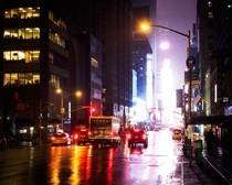 Rainy morning looking down th Avenue towards Times Square in Manhattan NYC USA
