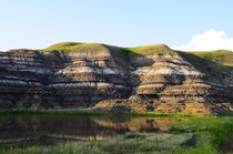 Randomly placed amongst hours of completely flat grasslands is this valley Many dinosaurs have first been discovered here and this area remains a hotbed for dinosaur fossils Drumheller Alberta Canada