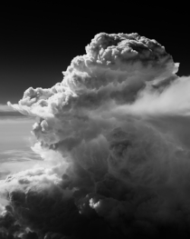 Rapidly rising cumulus clouds over the Sierra Nevada Mountains photographed from  feet