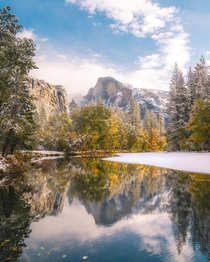 Rare glimpse of Half Dome with fall colors and snow Yosemite National Park California