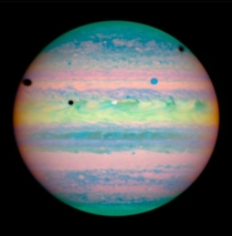Rare triple eclipse on Jupiter Three of Jupiters moons -- Io Ganymede amp Callisto cast dark shadows onto the planet