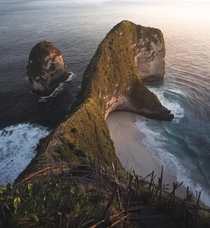 Rays of light cascading down a stretch of coastline in Nusa Penida Indonesia